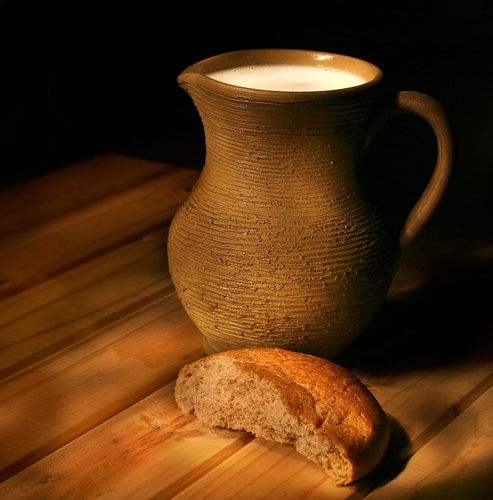 A photograph of Bread and milk